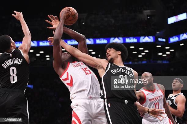 Clint Capela of the Houston Rockets fights for the ball against Jarrett Allen of the Brooklyn Nets during the game at Barclays Center on November 02,...
