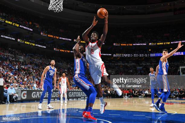 Clint Capela of the Houston Rockets goes to the basket against the Philadelphia 76ers October 25 2017 at Wells Fargo Center in Philadelphia...