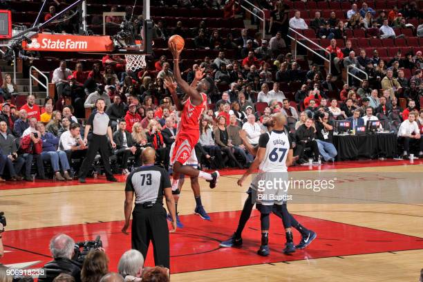 Clint Capela of the Houston Rockets goes to the basket against the Minnesota Timberwolves on January 18 2018 at the Toyota Center in Houston Texas...