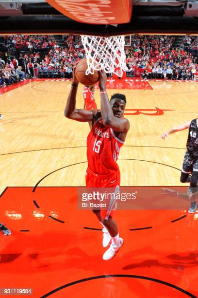 Clint Capela of the Houston Rockets goes to the basket against the San Antonio Spurs on March 12 2018 at the Toyota Center in Houston Texas NOTE TO...