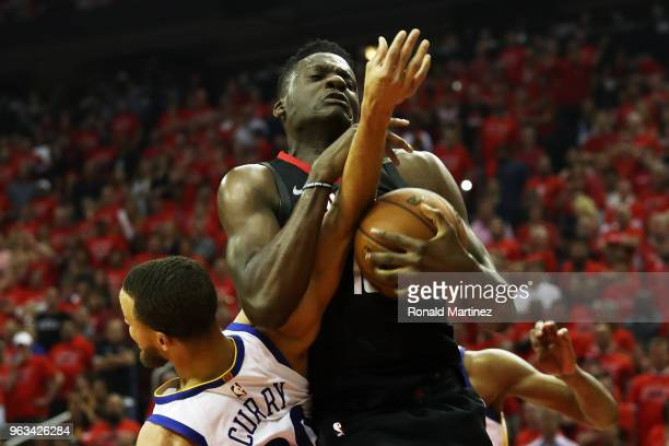 Clint Capela of the Houston Rockets goes up against Stephen Curry of the Golden State Warriors in the second quarter of Game Seven of the Western...