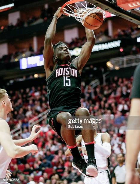 Clint Capela of the Houston Rockets goes up for a dunk against the San Antonio Spurs at Toyota Center on December 15 2017 in Houston Texas NOTE TO...