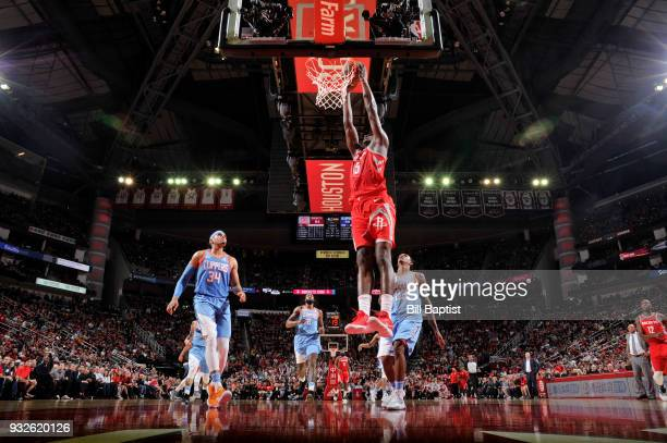 Clint Capela of the Houston Rockets goes up for a dunk against the LA Clippers on March 15 2018 at the Toyota Center in Houston Texas NOTE TO USER...