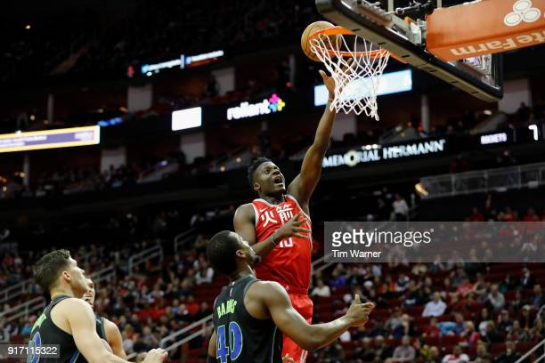 Clint Capela of the Houston Rockets goes up for a lay up defended by Harrison Barnes of the Dallas Mavericks in the first half at Toyota Center on...