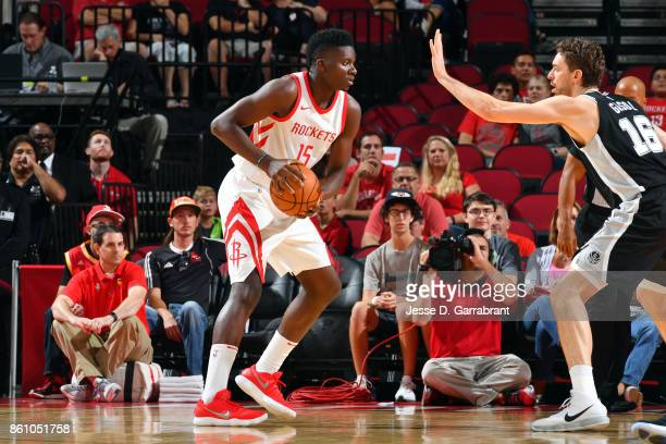 Clint Capela of the Houston Rockets handles the ball during the preseason game against the San Antonio Spurs on October 13 2017 at Toyota Center in...