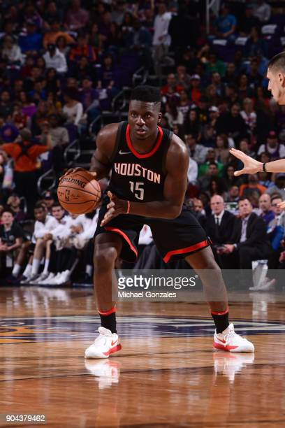 Clint Capela of the Houston Rockets handles the ball during the game against the Phoenix Suns on January 12 2018 at Talking Stick Resort Arena in...