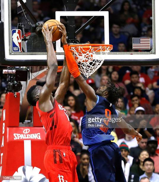 Clint Capela of the Houston Rockets has hit shot attempt blocked by Jerami Grant of the Oklahoma City Thunder during the third quarter at Toyota...