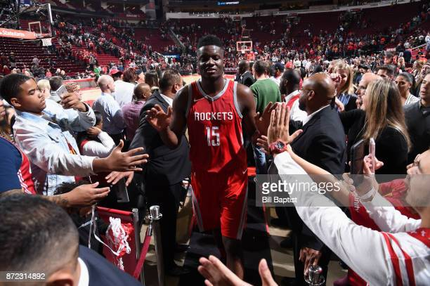 Clint Capela of the Houston Rockets high fives fans after the game against the Cleveland Cavaliers on NOVEMBER 9 2017 at the Toyota Center in Houston...