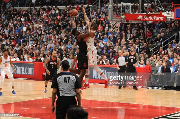 Clint Capela of the Houston Rockets is blocked by Wesley Johnson of the LA Clippers on January 15 2018 at STAPLES Center in Los Angeles California...