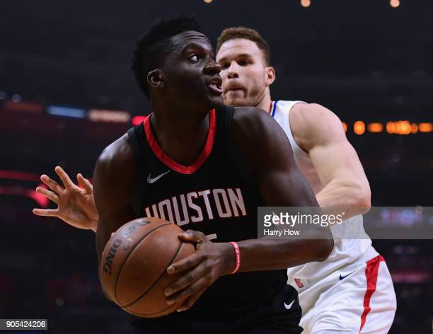 Clint Capela of the Houston Rockets looks at the basket as he is guarded by Blake Griffin of the LA Clippers during the first half at Staples Center...