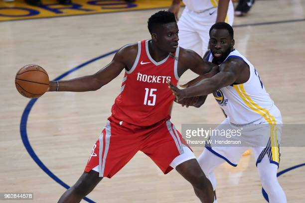 Clint Capela of the Houston Rockets looks to pass against Draymond Green of the Golden State Warriors during Game Six of the Western Conference...