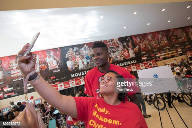 Clint Capela of the Houston Rockets participates in the 2017 Season of Giving presented by ZTE with a holiday party and a surprise bike giveaway on...