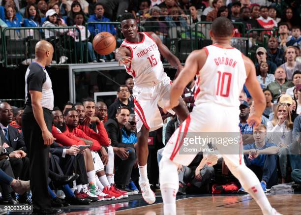 Clint Capela of the Houston Rockets passes the ball during the game against the Dallas Mavericks on March 11 2018 at the American Airlines Center in...