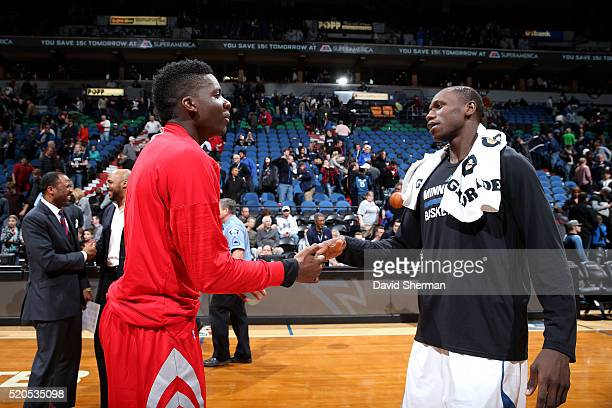 Clint Capela of the Houston Rockets shakes hands with Gorgui Dieng of the Minnesota Timberwolves after the game on April 11 2016 at Target Center in...