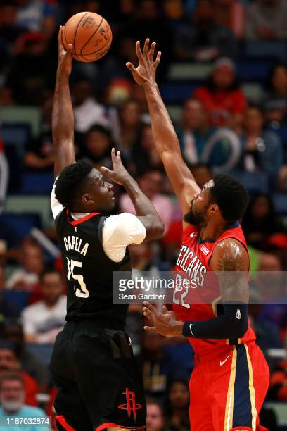 Clint Capela of the Houston Rockets shoots over Derrick Favors of the New Orleans Pelicans during a NBA game at the Smoothie King Center on November...