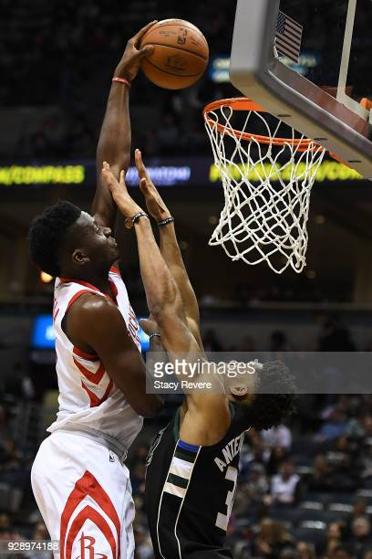 Clint Capela of the Houston Rockets shoots over Giannis Antetokounmpo of the Milwaukee Bucks during the second half of a game at the Bradley Center...