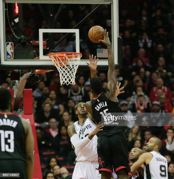Clint Capela of the Houston Rockets shoots over LaMarcus Aldridge of the San Antonio Spurs at Toyota Center on December 15 2017 in Houston Texas NOTE...