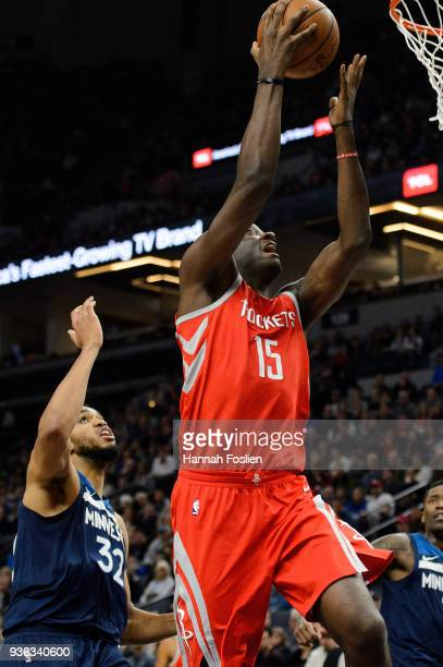 Clint Capela of the Houston Rockets shoots the ball against KarlAnthony Towns of the Minnesota Timberwolves during the game on March 18 2018 at the...