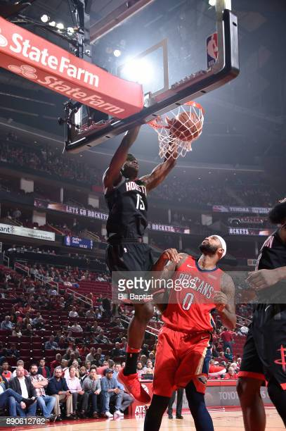 Clint Cappella of the Houston Rockets dunks against DeMarcus Cousins of the New Orleans Pelicans on December 11 2017 at the Toyota Center in Houston...