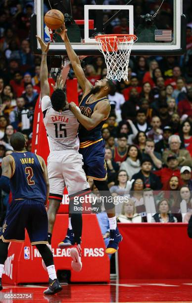 Clint Cappella of the Houston Rockets has his shot attempt blocked by Tristan Thompson of the Cleveland Cavaliers as Kyrie Irving looks on at Toyota...