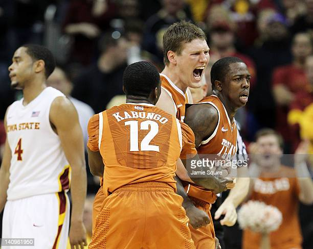 Clint Chapman and Myck Kabongo of the Texas Longhorns celebrate with J'Covan Brown after Brown scored late during the NCAA Big 12 basketball...