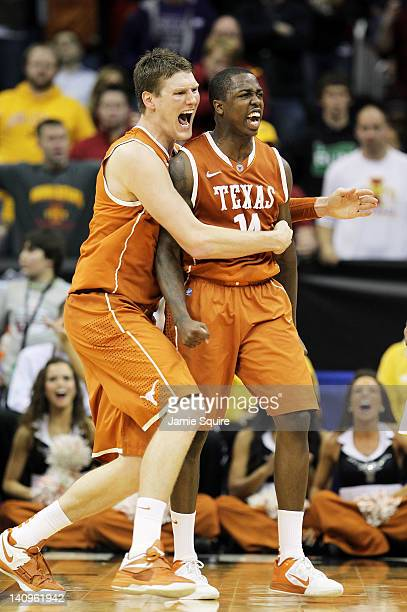 Clint Chapman of the Texas Longhorns hugs J'Covan Brown after Brown scored late during the NCAA Big 12 basketball tournament quarterfinal game...