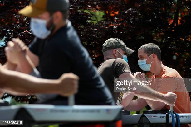 Clint Connelly and Devin O'Neill arm wrestle during the Frederick County Maryland Arm Wrestling Team's practice at the home of Sergey Svetlikov on...