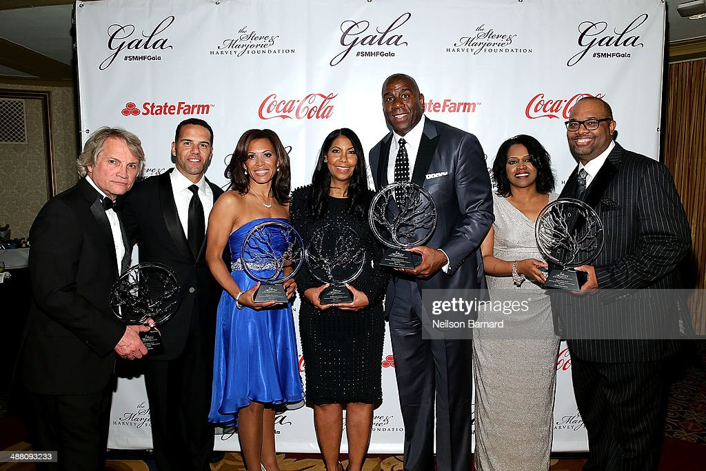 Clint Culpepper, Steve Pemberton, Tonya Pemberton, Cookie Johnson, Earvin 'Magic' Johnson, Delilah Brooks, and Pastor Corey Brooks pose with their awards at the 2014 Steve & Marjorie Harvey Foundation Gala presented by Coca-Cola at the Hilton Chicago on May 3, 2014 in Chicago, Illinois.
