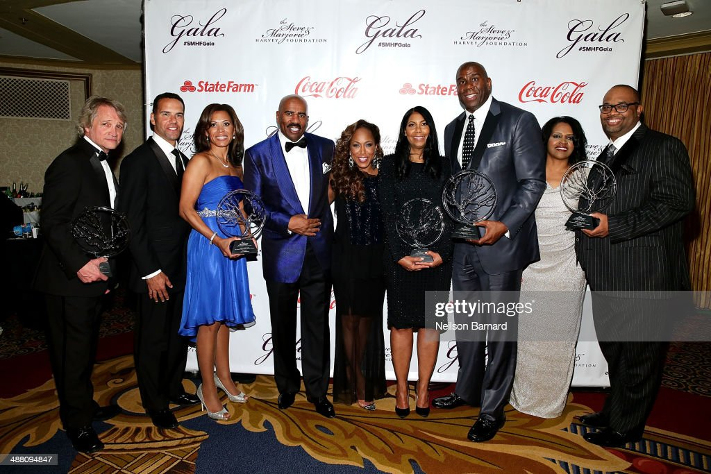 Clint Culpepper, Steve Pemberton, Tonya Pemberton, Steve Harvey, Marjorie Harvey, Cookie Johnson, Earvin 'Magic' Johnson, Delilah Brooks, and Pastor Corey Brooks pose with their awards at the 2014 Steve & Marjorie Harvey Foundation Gala presented by Coca-Cola at the Hilton Chicago on May 3, 2014 in Chicago, Illinois.