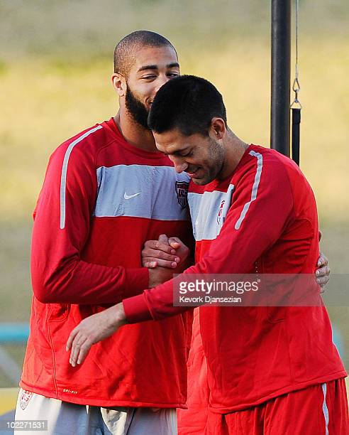 Clint Dempsey and Oguchi Onyewu of US national football team hug during training session at Pilditch Stadium on June 21 2010 in Pretoria South Africa...