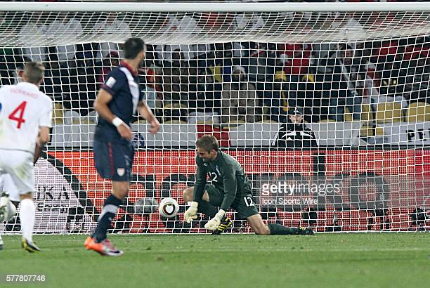 Clint Dempsey looks on as his goal strike is bobbled by goalie Robert Green for the equalizing goal of the match. The England National Team played...
