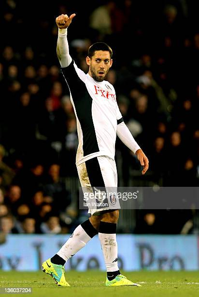 Clint Dempsey of Fulham appaluds the fans after scoring the opening goal during the Barclays Premier League match between Fulham and Bolton Wanderers...