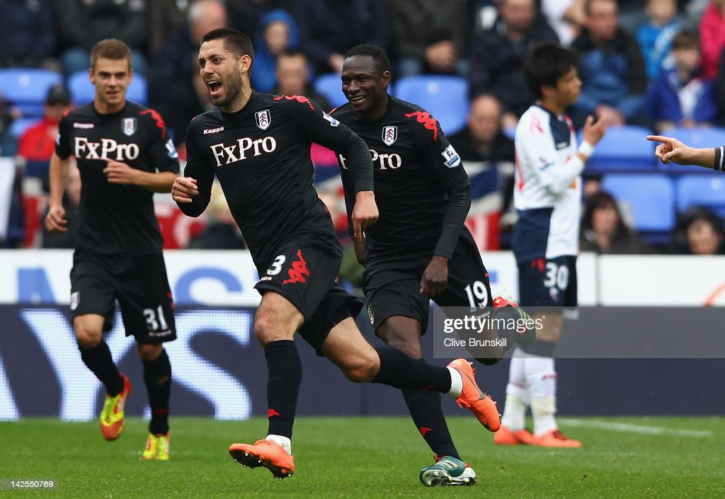 Clint Dempsey of Fulham celebrates after scoring his first goal from a free kick during the Barclays Premier League match between Bolton Wanderers and Fulham at Reebok Stadium on April 7, 2012 in Bolton, England.