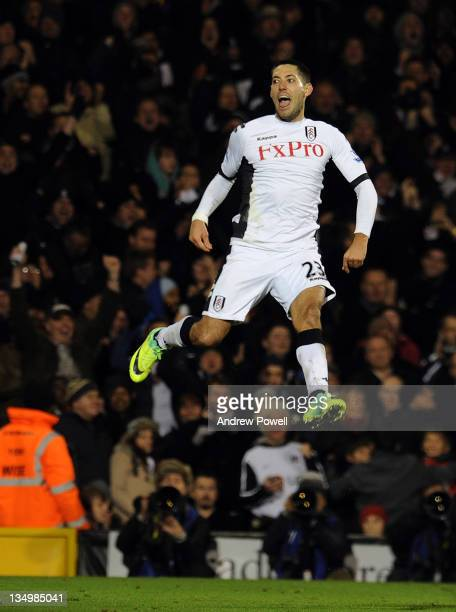 Clint Dempsey of Fulham celebrates after scoring the opening goal during the Barclays Premier League match between Fulham and Liverpool at Craven...