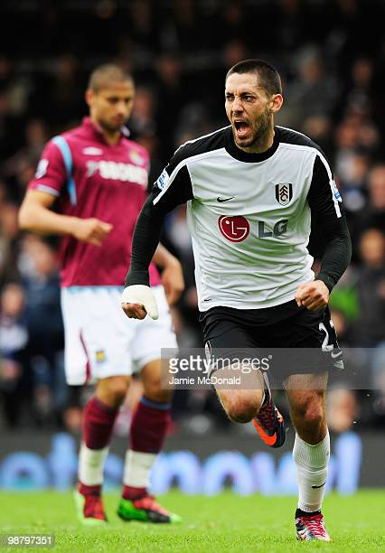 Clint Dempsey of Fulham celebrates as he scores their first goal during the Barclays Premier League match between Fulham and West Ham United at...