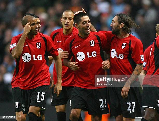 Clint Dempsey of Fulham celebrates with team mates after scoring the second equalizing goal during the Barclays Premier League match between...