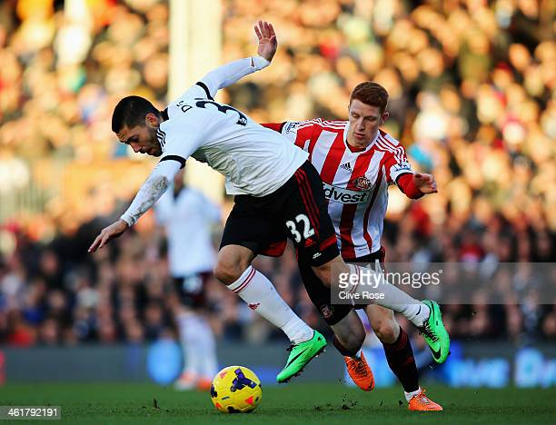 Clint Dempsey of Fulham holds off the challenge of Jack Colback of Sunderland during the Barclays Premier League match between Fulham and Sunderland...
