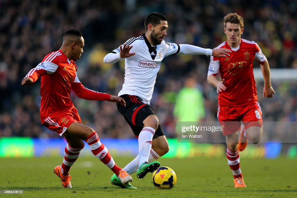 Clint Dempsey (C) of Fulham in action against Nathaniel Clyne and Steven Davis of Southampton during the Barclays Premier League match between Fulham and Southampton at Craven Cottage on February 1, 2014 in London, England.