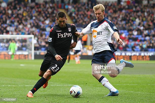 Clint Dempsey of Fulham in action with Tim Ream of Bolton Wanderers during the Barclays Premier League match between Bolton Wanderers and Fulham at...