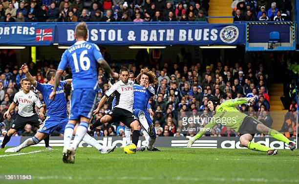 Clint Dempsey of Fulham scores a goal to level the scores at 11 despites the attentions of David Luiz and Petr Cech of Chelsea during the Barclays...