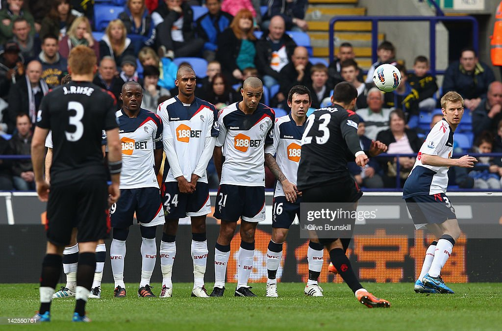 Clint Dempsey of Fulham scores his first goal from a free kick during the Barclays Premier League match between Bolton Wanderers and Fulham at Reebok Stadium on April 7, 2012 in Bolton, England.
