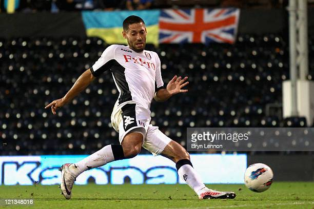 Clint Dempsey of Fulham scores his side's second goal during the UEFA Europa League Play-Off round qualifying first leg match between Fulham and FC...