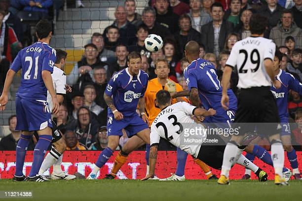 Clint Dempsey of Fulham scores the first goal during the Barclays Premier League match between Fulham and Bolton Wanderers at Craven Cottage on April...