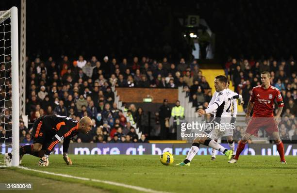Clint Dempsey of Fulham scores the opening goal during the Barclays Premier League match between Fulham and Liverpool at Craven Cottage on December 5...