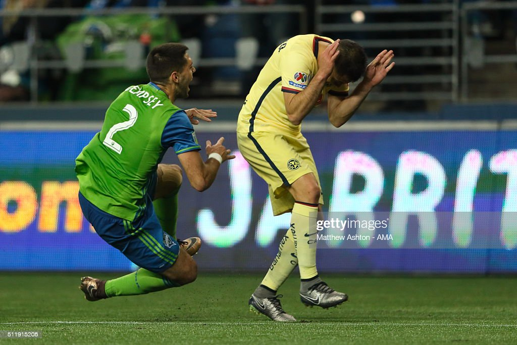 Clint Dempsey of Seattle Sounders collides with Jose Guerrero of Club America during the CONCACAF Champions League match between Seattle Sounders and Club America at CenturyLink Field on February 23, 2016 in Seattle, Washington.