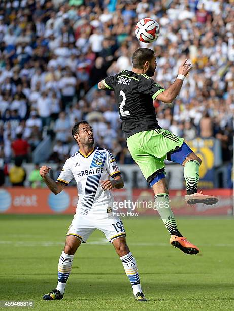 Clint Dempsey of Seattle Sounders FC heads the ball in front of Juninho of Los Angeles Galaxy during the Western Conference Final at StubHub Center...