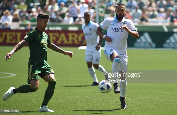 Clint Dempsey of Seattle Sounders goes after a ball against Liam Ridgewell of Portland Timbers during the second half of the match against the...