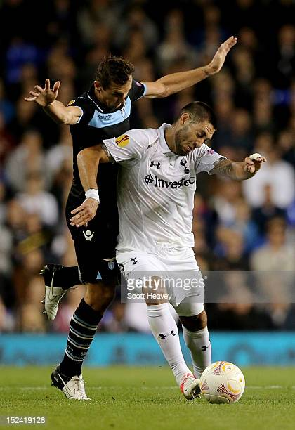 Clint Dempsey of Spurs holds off the challenge from Miroslav Klose of Lazio during the UEFA Europa League group J match between Tottenham Hotspur and...