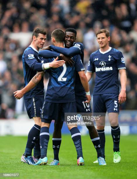 Clint Dempsey of Spurs is congratulated after scoring a goal to level the scores at 11 during the Barclays Premier League match between Stoke City...