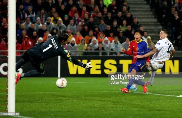 Clint Dempsey of Spurs scores his team's second goal past diving goalkeeper Yann Sommer of Basel during UEFA Europa League quarter final second leg...